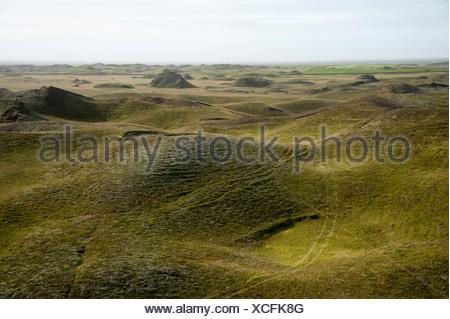 Green hills in back light, meadow, at Kirkjubæjarklaustur, South Iceland, Iceland, Europe - Stock Photo