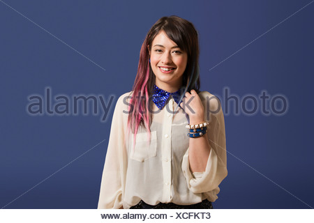 Portrait of young woman with dyed hair - Stock Photo