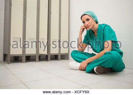 Nurse Changing Surgical Dressing On Patient After Back