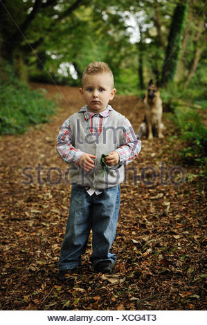 Little Boy In A Forest - Stock Photo