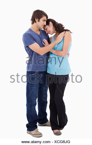 Portrait of a lovely couple embracing each other - Stock Photo