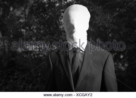 Faceless Halloween Man with covered face - Stock Photo