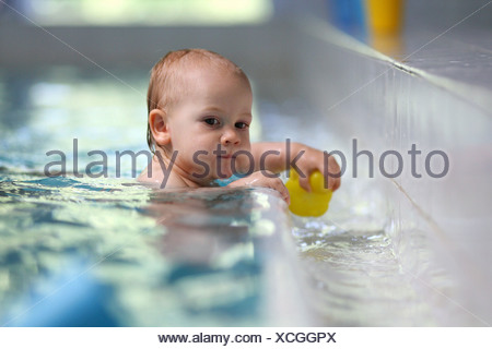 Berlin, Germany, the child baby swimming - Stock Photo