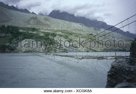 Pakistan,Passu,Hunzafluss,suspension bridge,Asia,Karakorumgebirge,Karakorum,scenery,mountains,mountains,river,Hunza,water,bridge,rock,valley,water,deserted,boards,woodwork,gaps,broken,ramshackle, - Stock Photo