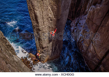 Two climbers at the start of the first pitch of the Totem Pole. - Stock Photo