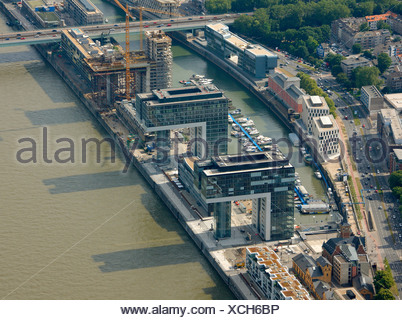 Aerial photograph, Kranhaus crane house construction site in Cologne Rheinauhafen, Pandion AG, Hafenquartier port district, Neu - Stock Photo