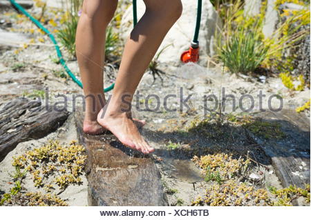 Low section view of a woman washing her feet - Stock Photo