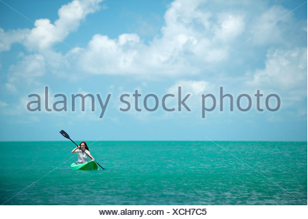 A woman kayaks in Florida. - Stock Photo