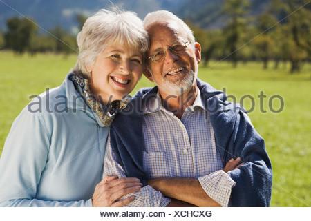 Austria, Karwendel, Ahornboden, Senior couple, smiling, portrait - Stock Photo