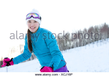 Young woman in skiing resort - Stock Photo