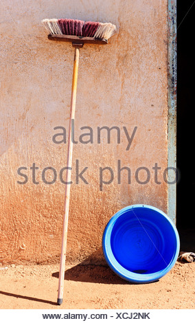 Old mop against a wall - Stock Photo