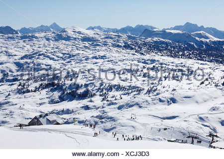 Ski area of Krippenstein Mountain with Margschierf Mountain and the Dachstein Mountains, Salzkammergut, Upper Austria, Austria - Stock Photo