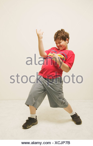 A boy playing the air guitar - Stock Photo