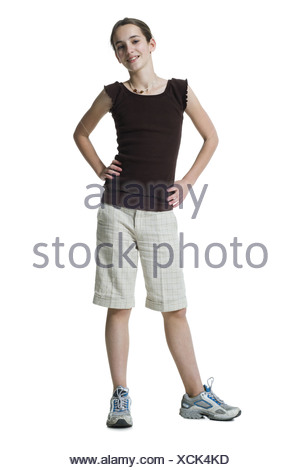 Girl standing with hands on hips - Stock Photo