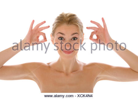 Beautiful woman cleans ears wadded sticks - Stock Photo