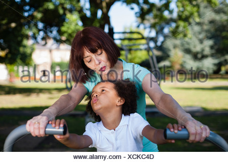 Woman and granddaughter playing in park - Stock Photo