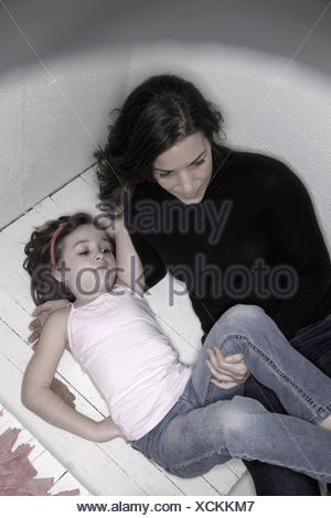 Mother holding her young daughter.  Model and Property Released. - Stock Photo