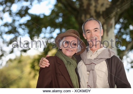 Elderly couple taking a walk together in the forest - Stock Photo
