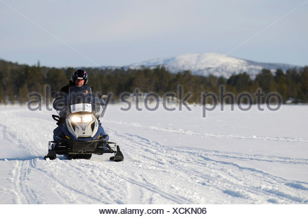 Snowmobile tour on Lake Inari, Inari, Lapland, Finland, Europe - Stock Photo