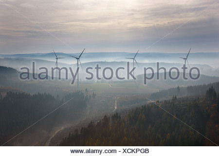 Aerial photo, wind turbines in morning fog, Sauerland valleys, Meschede, Sauerland, North Rhine-Westphalia, Germany, Europe - Stock Photo