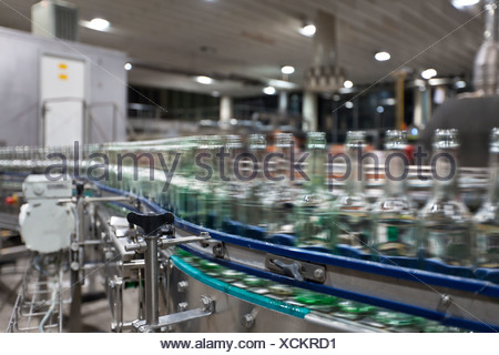 Empty beer bottles after cleaning, moving on a conveyor belt, Binding brewery, Frankfurt, Hesse, Germany, Europe - Stock Photo