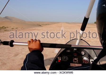 Takeoff for a microlight flight over the Gobi Desert, aerial view of sand dunes in the Gobi Desert, Silk Road, Dunhuang, Gansu, - Stock Photo