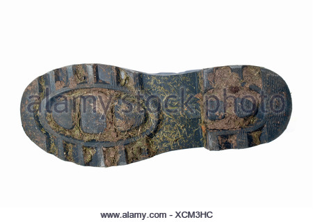 The bottom of a muddy Wellington boot - Stock Photo