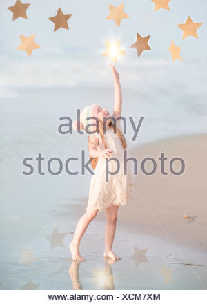 Girl reaching for the stars - Stock Photo