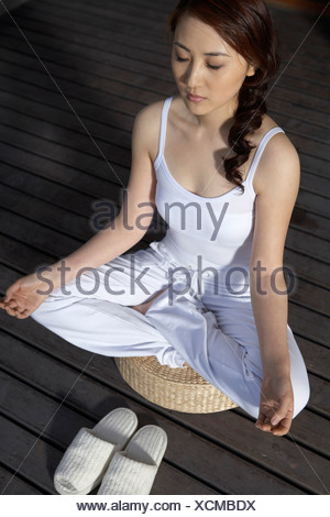 Woman Meditating On Deck