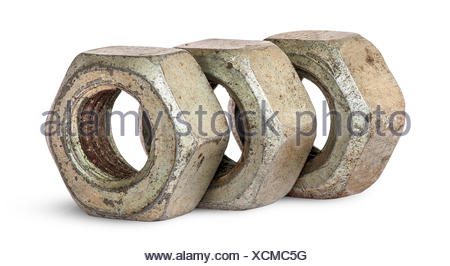 Three old rusty nuts in a row rotated - Stock Photo