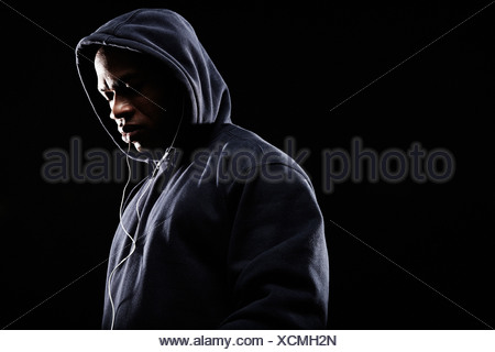 Mid adult man wearing hooded top - Stock Photo