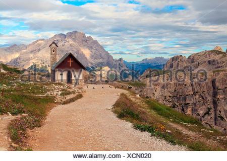 Tre Cime di Lavaredo, Trentino Alto Adige, Italy, A beautiful alpine church on the trail that connects the Auronzo refuge with the Three Peaks of Lavaredo - Stock Photo