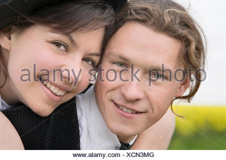 Young woman embracing her partner - Stock Photo