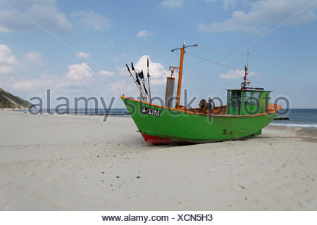 Fishing boats on the beach of the Baltic Sea near Misdroy in the national park Wollin in the West Pomeranian Voivodeship, Poland - Stock Photo