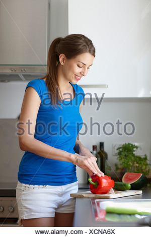 Woman cutting red pepper - Stock Photo