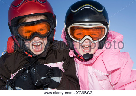Portrait of young girls in ski kit - Stock Photo