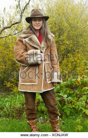 Older woman wearing fur lined coat - Stock Photo
