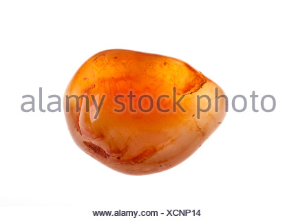 Cutout of a Carnelian (also spelled cornelian) gemstone on white background - Stock Photo