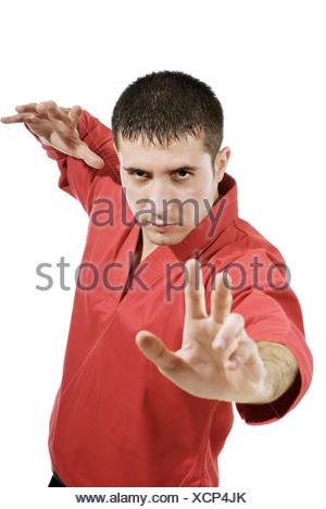 serious man in red kimono - Stock Photo