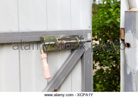 locking bolt on an iron fence - Stock Photo