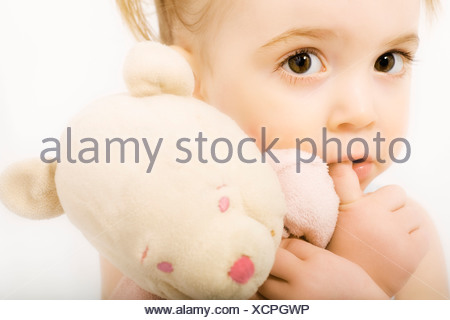 Little girl with teddy bear - Stock Photo