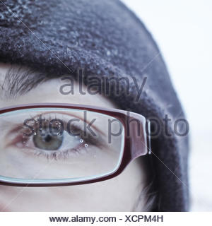 Water drops on a woman's spectacle glasses - Stock Photo