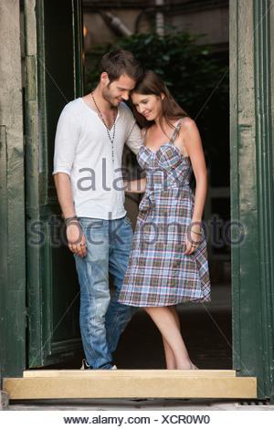 Romantic couple at a doorway, Paris, Ile-de-France, France - Stock Photo