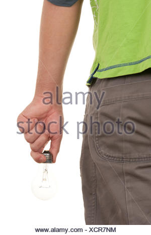 and holds incandescent lamp behind - Stock Photo