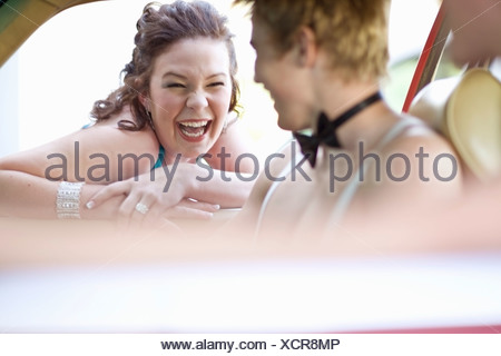 Teenagers in formal wear laughing - Stock Photo