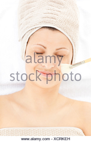 Charming relaxed woman receiving beauty treatment - Stock Photo