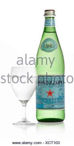 San Pellegrino mineral water, bottle and glass, clipping path available - Stock Photo