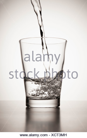 Water pouring into glass - Stock Photo