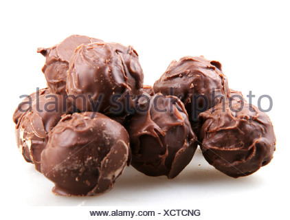 stacked chocolate candy on white background - Stock Photo