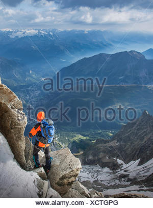 Mountain climber descending the Dent du Geant, in the Mont Blanc Massif, Courmayeur, Aosta Valley, Italy, Europe - Stock Photo